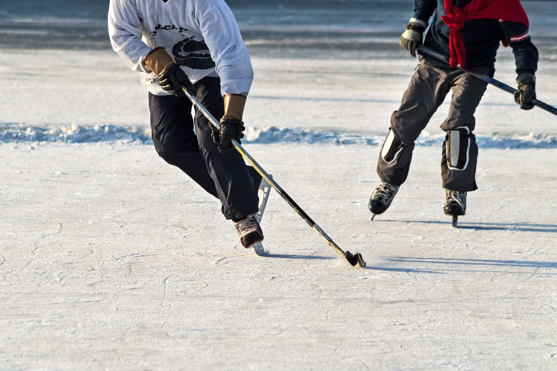 Guys playing pond hockey in Peace River